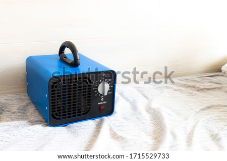generator converter disinfectant ozone inside a home. covid 19 Royalty-Free Stock Photo #1715529733