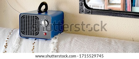 generator converter disinfectant ozone inside a home. covid 19 Royalty-Free Stock Photo #1715529745