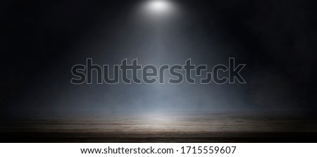 Empty wooden table with smoke float up on dark background, perspective wooden floor shelf table, used as a studio background wall to display your products. #1715559607