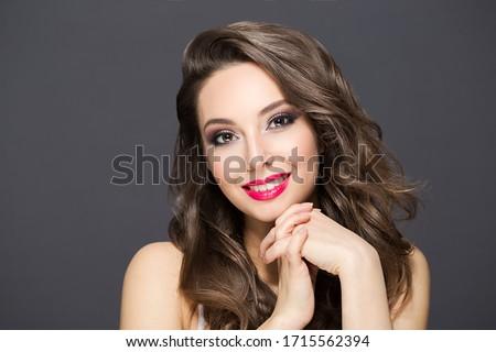 Portrait of a gorgeous brunette in elegant makeup. #1715562394