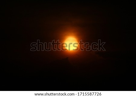 Sun little hazy during Sunrise with black background.  #1715587726