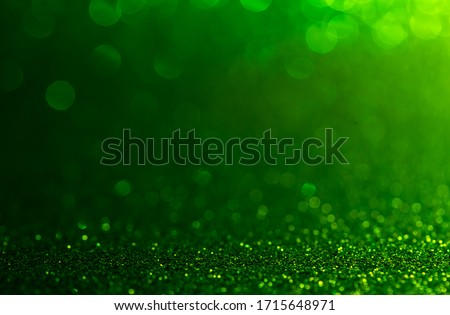 green Sparkling Lights Festive background with texture. Abstract Christmas twinkled bright bokeh defocused #1715648971