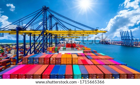 Container ship unloading in deep sea port, Global business logistic import export freight shipping transportation oversea worldwide by container ship open sea, Container vessel loading cargo freight. #1715665366