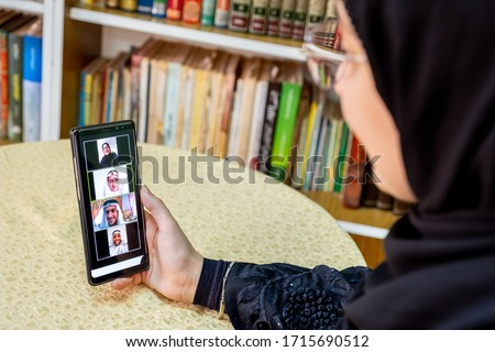 Arabic muslim people using video conference app online Royalty-Free Stock Photo #1715690512