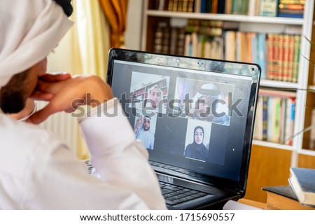 Arabic muslim people using video conference app online Royalty-Free Stock Photo #1715690557