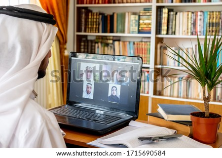 Arabic muslim people using video conference app online Royalty-Free Stock Photo #1715690584