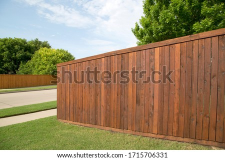 Nice wooden fence around house Royalty-Free Stock Photo #1715706331