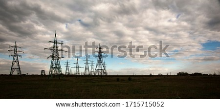 The clouds over the power lines are magnificent.Power lines and sky with clouds.Powerful lines of electric gears.Electric power industry and nature concept.High voltage power lines. #1715715052