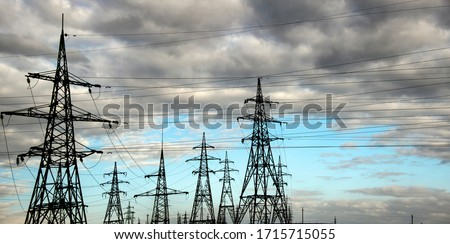 The clouds over the power lines are magnificent.Power lines and sky with clouds.Powerful lines of electric gears.Electric power industry and nature concept.High voltage power lines. #1715715055