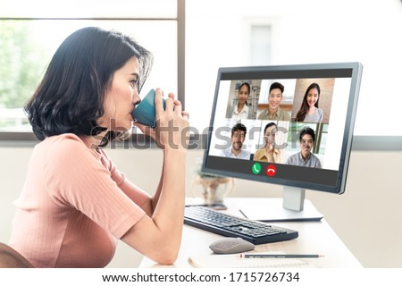 Asian young business woman sit and drink coffee while open files and work in laptop. During Coronavirus crisis Covid19 outbreak, Social distancing girl work from home for prevent contract a disease. #1715726734