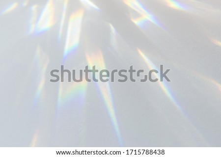 Blurred overlay effect for photo and mockups. Wall texture with organic drop diagonal shadow and rays of light on a white wall. shadows for natural light effects #1715788438