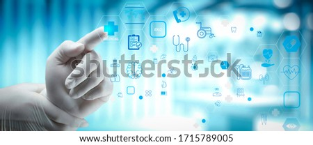 Health care and medical technology services concept with tele medicine and AR interface.Smart medical doctor working with operating room as concept