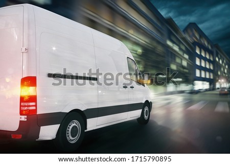 Super fast delivery of package service with a fast moving van on cityscape #1715790895