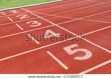 Running track with number in stadium. Close up start position in athlete track. Royalty-Free Stock Photo #1715800117