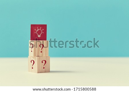 Good idea. Innovation. Creative thinking. Questions and answers. Wooden cubes with red block on top, lightbulb sign #1715800588