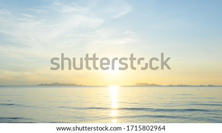 Beautiful beach sunrise with blue sea and golden light sky  cloud background #1715802964
