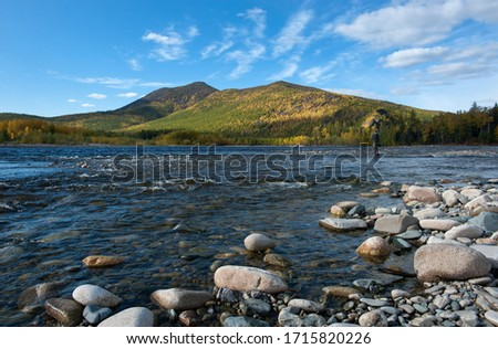 Autumn on the wild forest river. Wild nature landscape. Fishing in far est. Stones on the shore of taiga river #1715820226