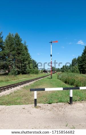 The semaphore position is prohibitive. Old semaphore on the narrow gauge railway. Analog semaphore on the railway. #1715856682