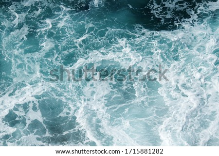Sea water top view. Abstract natural blue wave splash background.