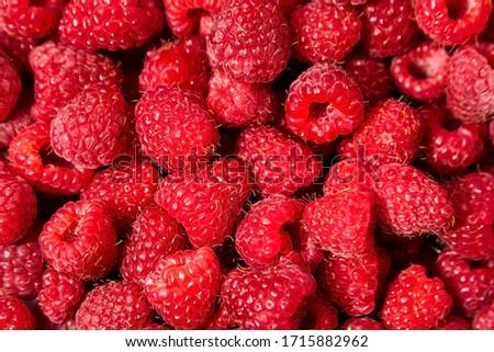 Raspberries background. Fresh red berries of ripe raspberries Royalty-Free Stock Photo #1715882962