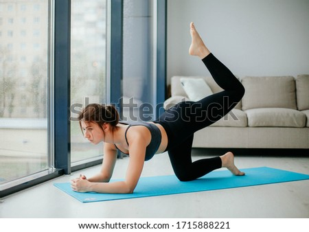 young woman doing fitness. sport at home.  #1715888221