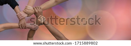 Group of professional people united hands together to build team working on teamwork with spiritual mind that can make more successful at work, Bokeh background and copy space for text. Royalty-Free Stock Photo #1715889802