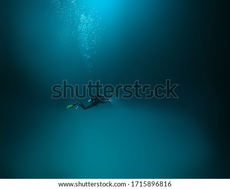 cenote angelita, mexico, cave diving, extreme adventure underwater, landscape under water fog Royalty-Free Stock Photo #1715896816