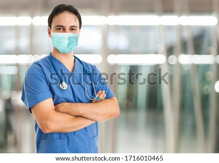 Masked doctor in the hospital, coronavirus healthcare concept #1716010465