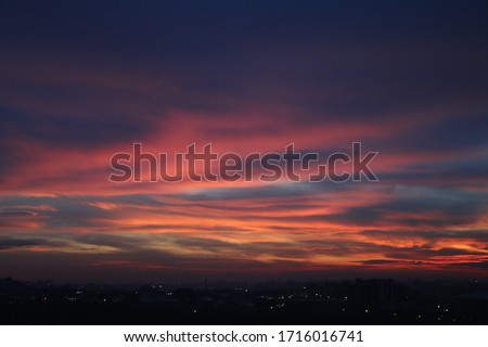 Natural Sunset Sunrise Over Field Or Meadow. Bright Dramatic Sky And Dark Ground. Countryside Landscape Under Scenic Colorful Sky At Sunset Dawn Sunrise. Sun Over Skyline, Horizon. Warm Colours. Royalty-Free Stock Photo #1716016741