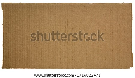 rectangular piece of corrugated brown cardboard isolated on white Royalty-Free Stock Photo #1716022471