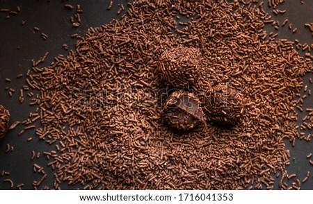 Brigadeiro (Brigadier) a Brazilian chocolate candy. Traditional Brazilian handmade chocolate sweet on dark background Royalty-Free Stock Photo #1716041353