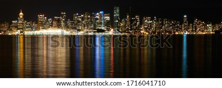 The nighttime skyline of downtown Vancouver, British Columbia, Canada, seen from Waterfront Park in North Vancouver.