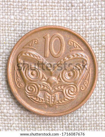 Hi resolution close up macro shot of a vintage copper coin on a fabric background 10 face old