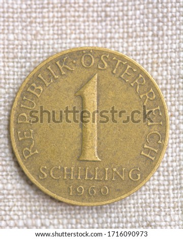 Hi resolution close up macro shot of a vintage bronze coin on a fabric background 1 1960