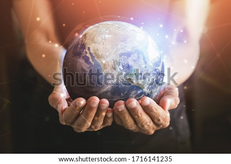 Businessman holding in hands with global connection concept. Energy saving concept, Elements of this image furnished by NASA #1716141235