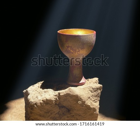 Holy Grail Sitting on a Rock Royalty-Free Stock Photo #1716161419