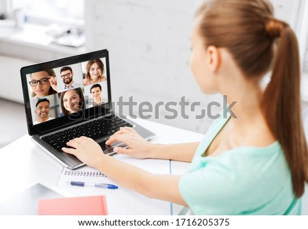 technology, remote job and online education concept - young woman or student girl with laptop computer having video call with colleagues or teachers at home #1716205375