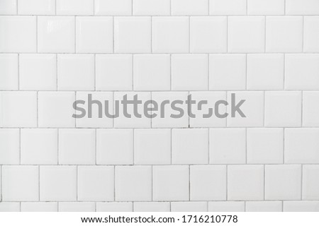 Close up. White tile interior wall background.