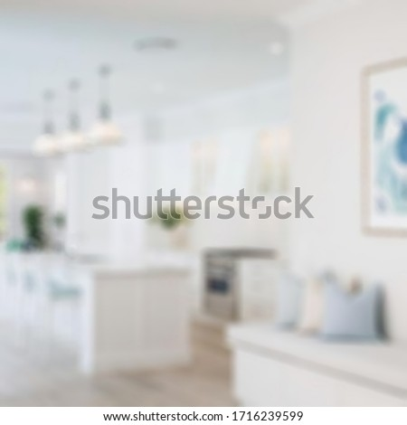 Lovely kitchen with hardwood floor, and nice counter tops.blurred background. #1716239599