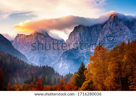 Triglav mountain peak at sunrise with beautiful clouds in morning light. Slovenia, Triglav National Park