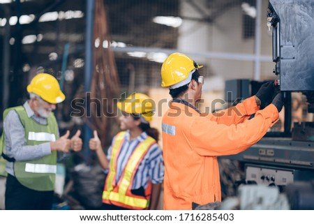 professional technician engineer control machine in factory #1716285403