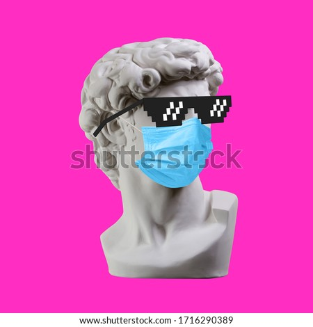 Statue. Earphone. Isolated. Gypsum statue of David's head. Man. Creative. Plaster statue of David's head in pixel glasses and medical mask. Minimal concept art. #1716290389