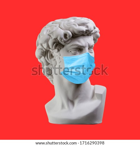 Statue. Earphone. Isolated. Gypsum statue of David's head. Man. Creative. Plaster statue of David's head in medical mask. Minimal concept art. #1716290398
