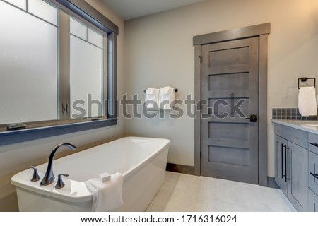 Natural new classic slick bathroom interior with modern and rustic natural design with white tub. #1716316024