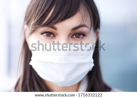Young sick asian girl 24-26 year old wearing medical outdoors. Looking at camera. Coronavirus. Social distancing. Quarantine time. Stay home.  #1716332122