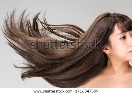 Women's hair is vibrant and shining. #1716347509