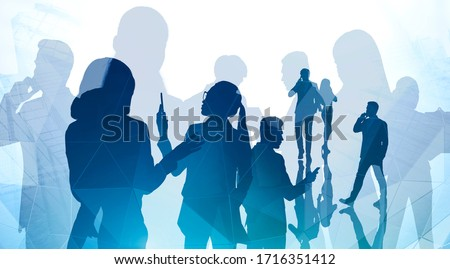 Silhouettes of business people using smartphones in abstract city. Concept of teamwork and communication. Toned image Royalty-Free Stock Photo #1716351412