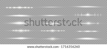 White horizontal lens flares pack. Laser beams, horizontal light rays. Beautiful light flares. Glowing streaks on light  background. Luminous abstract sparkling lined background. Royalty-Free Stock Photo #1716356260