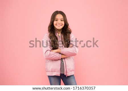 Casual autumn style. Fashion autumn outfit. Fashion trends for kids. Keeping active in fall. You need it for autumn. Happy child show handguns pink background. Little girl with autumn look. #1716370357