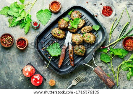 Appetizing homemade nettle meatballs cooked in grill pan #1716376195